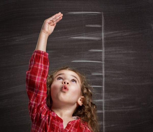 Kind misst Größe - Resilienz